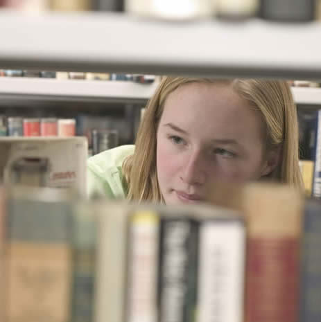 Employment @ WTML-Young Woman in Library Stacks-copyrighted image/Fotolia.com