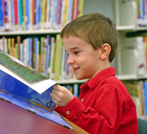PreSchooler Reading in Library