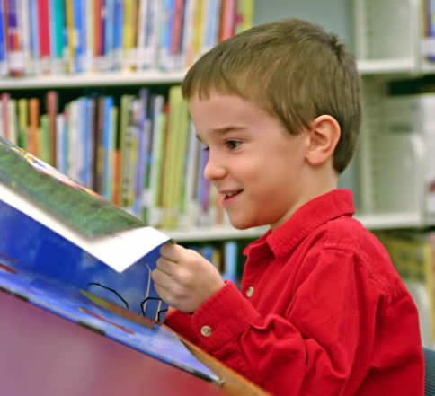Pre-Schooler Reading in Library