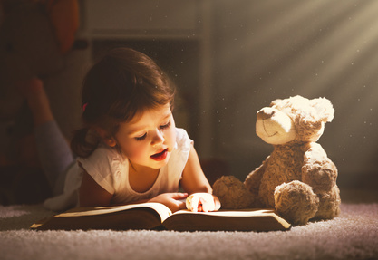 Girl Reading to Teddy Bear-copyright JenkoAtaman/Fotolia.com