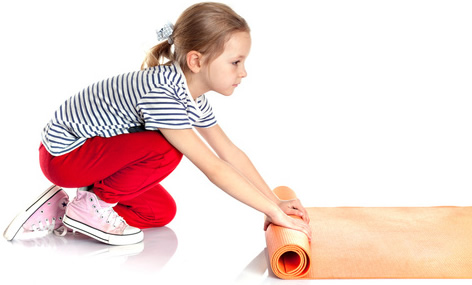 Girl with Yoga Mat-copyright photo_mts/Fotolia.com