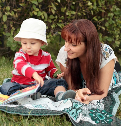 Mother and Child Reading Outdoors-copyrighted image