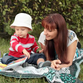 Mother and Child Reading Outdoors-copyright lanych/Fotolia.com