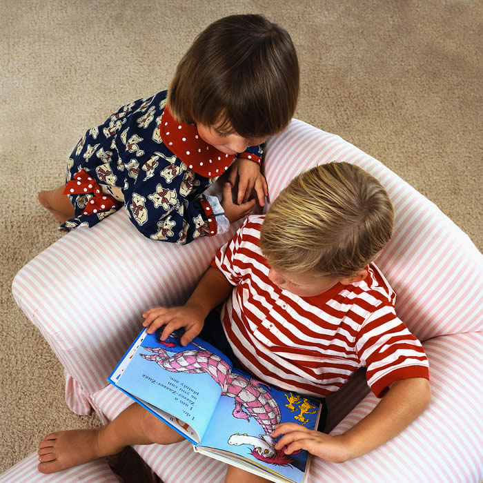 Boy and Girl Reading at Bedtime