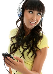 Woman Listening to Music-copyright Leah-Anne Thompson/Fotolia.com