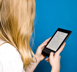Woman Using eReader Device